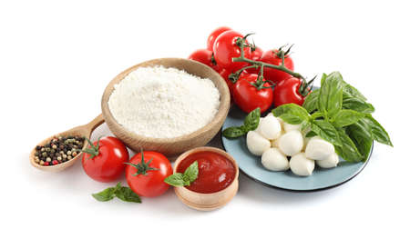 Fresh ingredients for pizza on white background