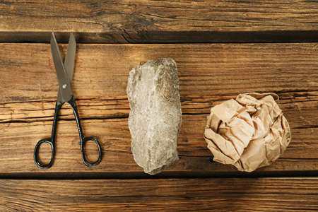 Flat lay composition with rock, paper and scissors on wooden background 版權商用圖片