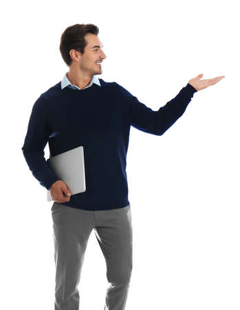 Young male teacher with laptop on white background Stock Photo