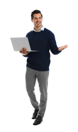 Young male teacher with laptop on white background Stock Photo - 129029003