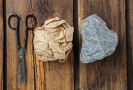 Flat lay composition with rock, paper and scissors on wooden background Zdjęcie Seryjne