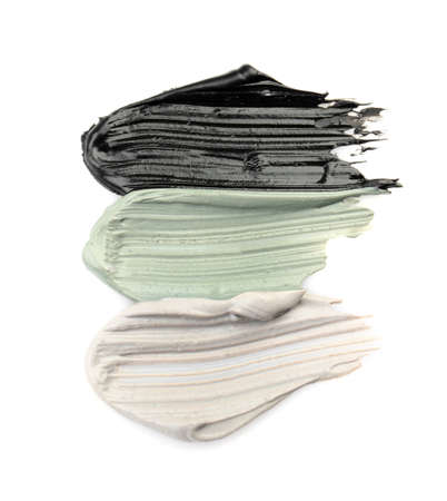 Different professional face mask smears on white background