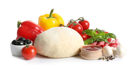Fresh dough and ingredients for pizza on white background