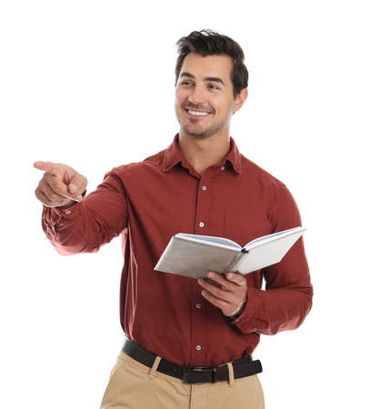 Young male teacher with book on white background
