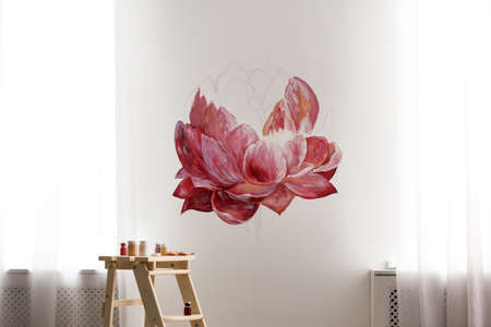 Unfinished flower painting on white wall in room. Interior design
