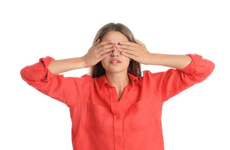 Young woman being blinded on white background