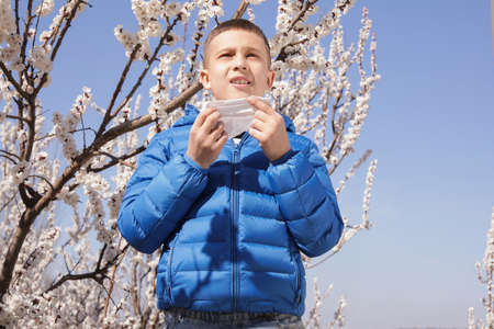 Little boy suffering from seasonal allergy outdoors on sunny day Stok Fotoğraf