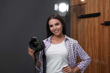 Professional photographer with modern camera in studio Stok Fotoğraf