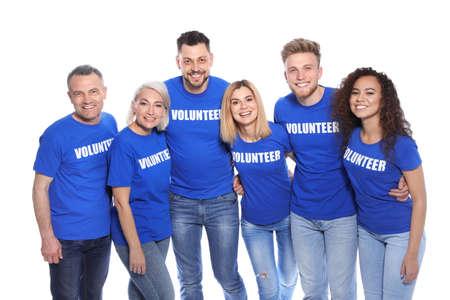 Team of volunteers in uniform on white background