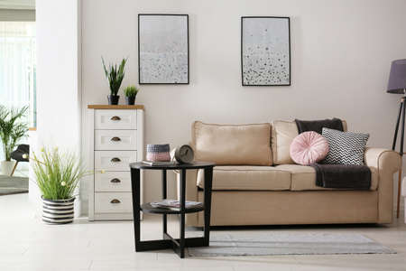Stylish living room with different decorative elements. Idea for interior design