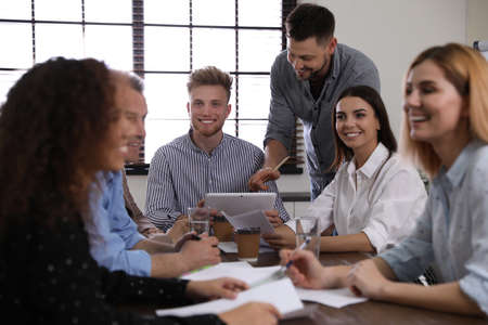 Portrait of volunteers having meeting in office 스톡 콘텐츠