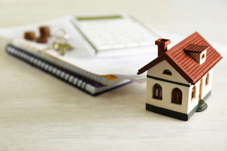 House model and real estate agents items on light table 版權商用圖片