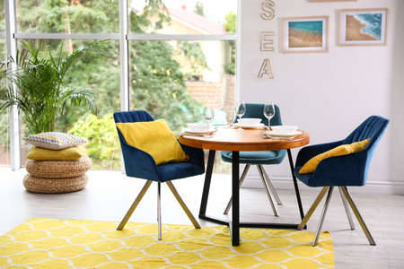 Modern dining room interior with served table and chairs 写真素材