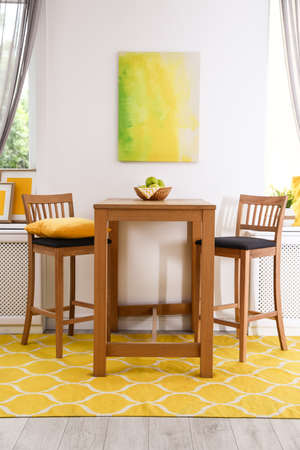 Modern dining room interior with wooden table and chairs