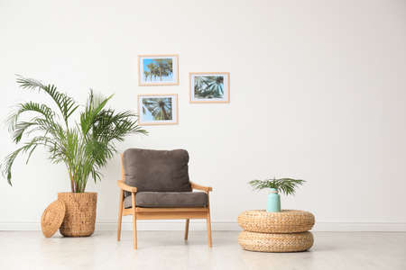 Stylish living room interior with wooden armchair and plants near white wall. Space for text 写真素材 - 128831248