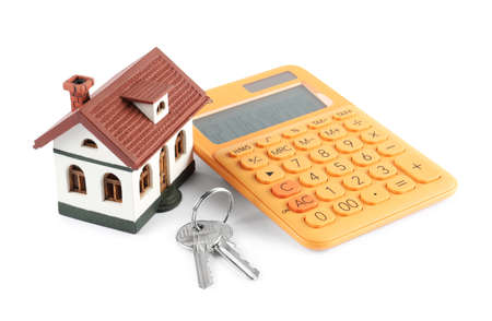 Calculator, keys and house model on white background. Real estate agent concept