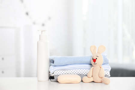 Baby accessories on table in nursery room. Space for text
