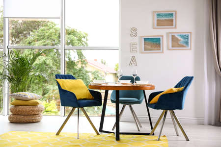 Modern dining room interior with served table and chairs Stock fotó