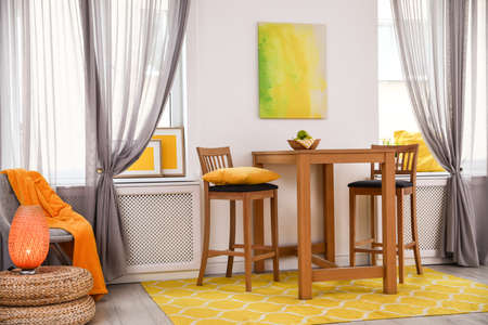 Modern dining room interior with wooden table and chairs 写真素材 - 128832460