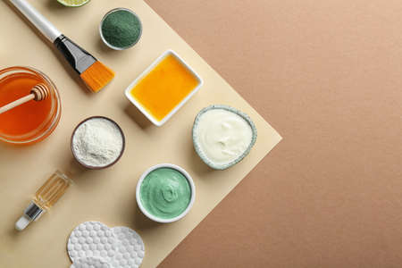 Flat lay composition with spirulina facial mask and ingredients on color background