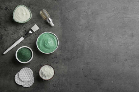 Flat lay composition with spirulina facial mask and ingredients on grey table. Space for text