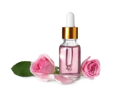 Bottle of essential oil and roses on white background