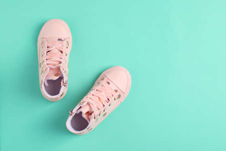 Pair of stylish child shoes on turquoise background, flat lay. Space for text 写真素材