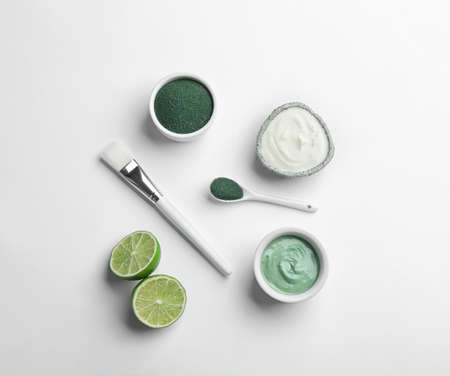 Composition with spirulina facial mask and ingredients on white background, top view 写真素材