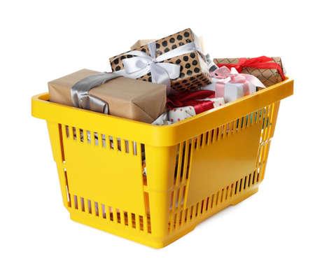 Shopping basket full of gift boxes on white background Imagens