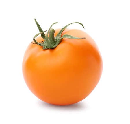 Delicious ripe orange tomato on white background