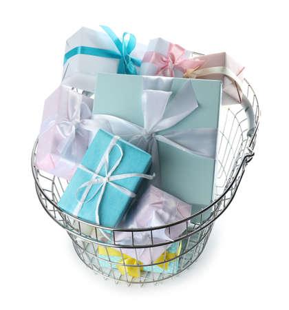 Shopping basket full of gift boxes on white background Stock Photo