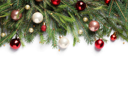 Fir branches with Christmas decorations on white background, flat lay
