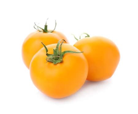 Delicious ripe orange tomatoes on white background