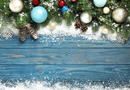 Christmas decoration with white snow on blue wooden background, flat lay. Space for text Stockfoto