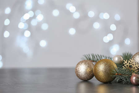 Christmas decoration on table against blurred lights. Space for text Stockfoto