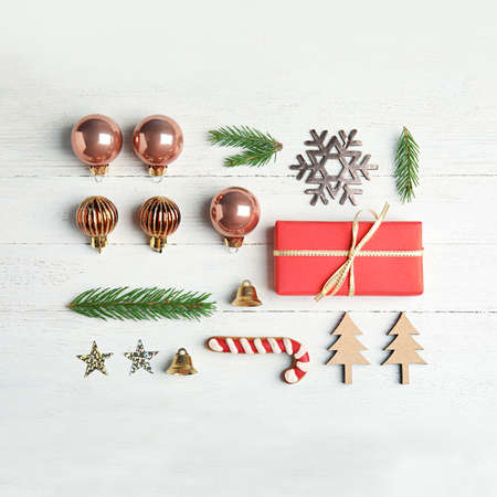Flat lay composition with Christmas decor on white wooden background
