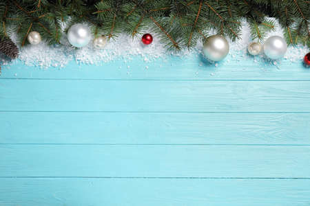 Christmas decoration with white snow on light blue wooden background, flat lay. Space for text Imagens - 128833192