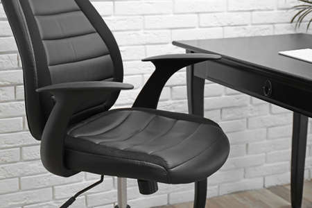 Modern office chair in stylish workplace interior