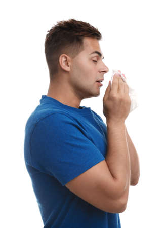 Young man suffering from allergy on white background