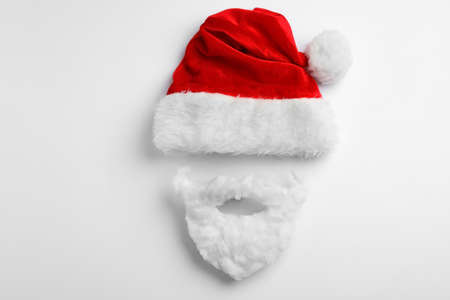Santa Claus hat with beard on white background, top view Imagens - 128832113