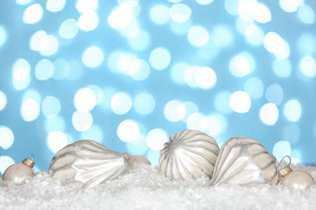 Christmas decoration on snow against blue background