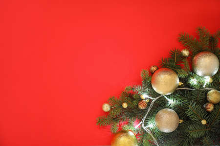 Christmas decoration on red background, flat lay. Space for text