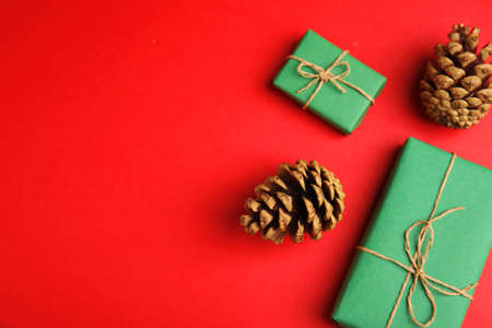 Flat lay composition with Christmas decor on red background. Space for text Stock fotó