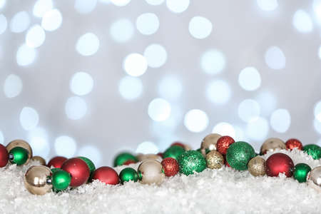Christmas decoration on snow against blurred background