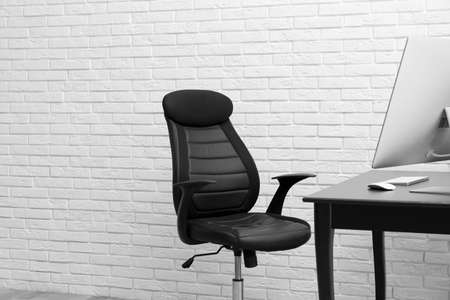 Stylish workplace interior with modern office chair 写真素材