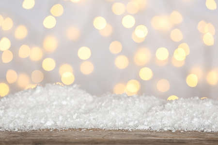 Heap of snow on wooden surface against blurred background. Christmas season Stock fotó