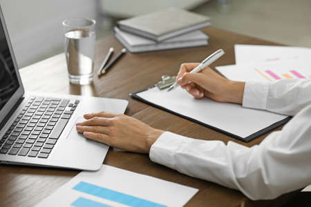 Business trainer working at table in office, closeup Stockfoto