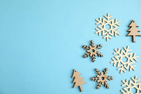 Flat lay composition with Christmas decor on blue background. Space for text