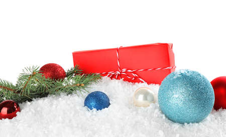 Christmas decoration with gift box on snow against white background