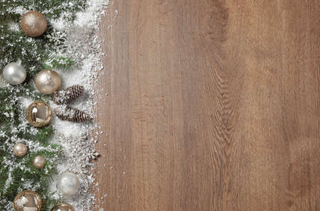 Christmas decoration with snow on wooden background, flat lay. Space for text Imagens - 128832504